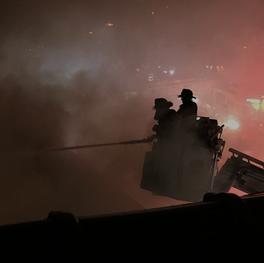 Firefighters in a bucket ladder.