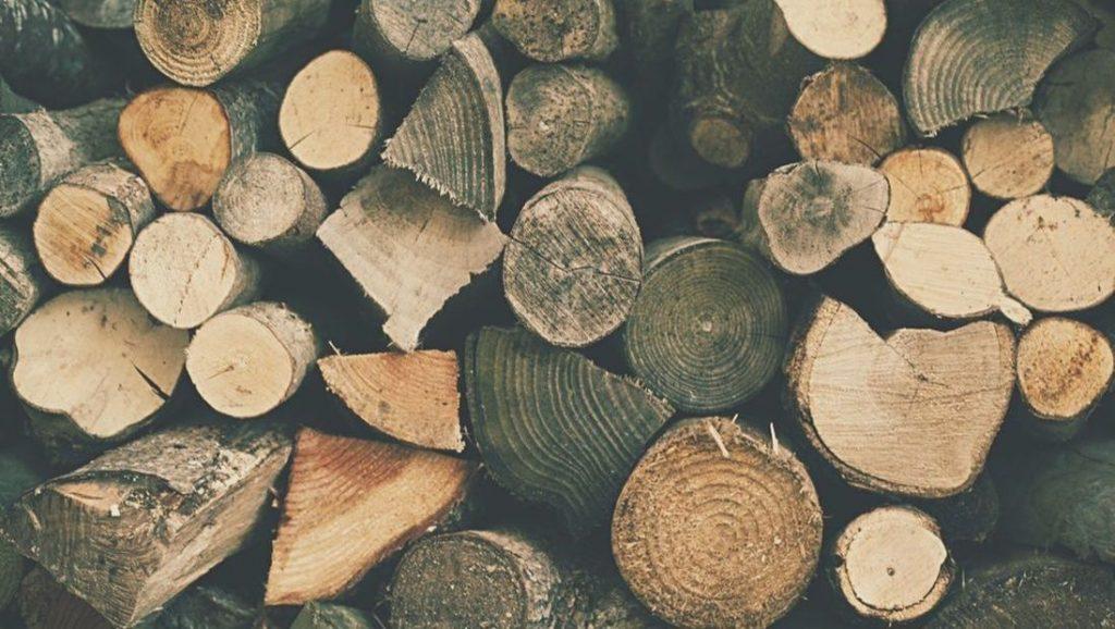 A closeup image of a woodpile.