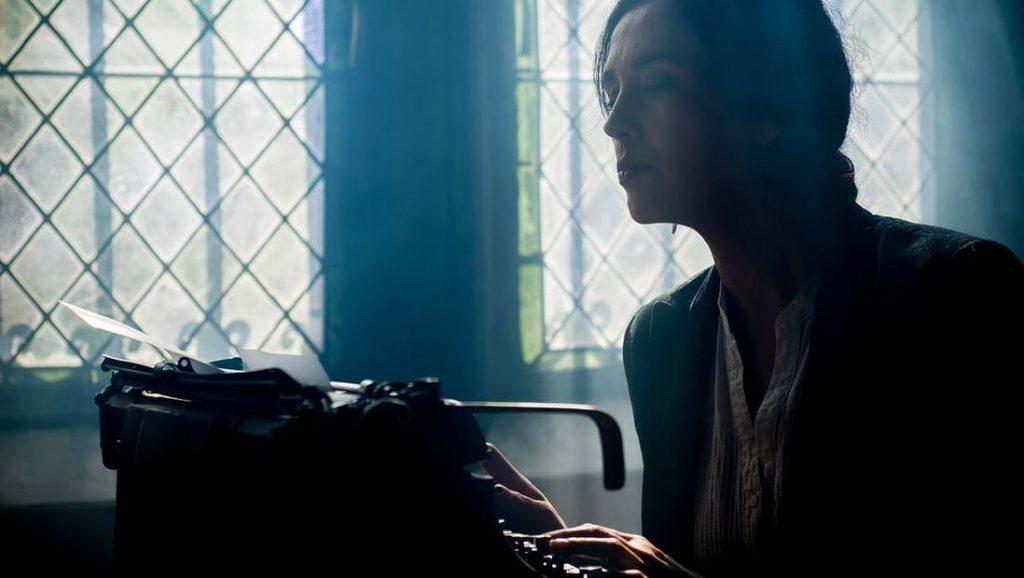 A woman at a typewriter.